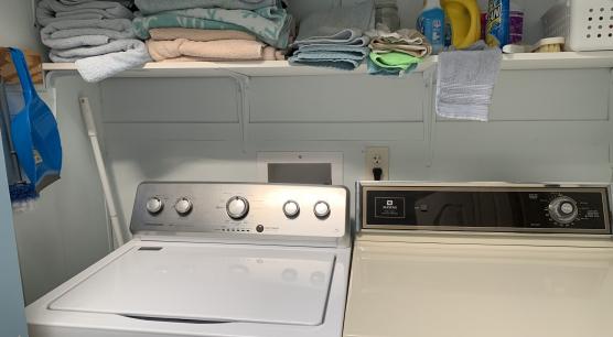 Utility Closet In Guest Bath